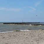 A view of the breakwall and lighthouse from Conneaut Beach