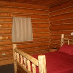 Separate bedroom in cabin #5 with TV, other 2 bedrooms with TV are in the main part of the cabin