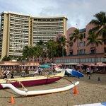 Exterior of Royal Hawaii dwarfed by Sheraton Waikiki