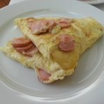 Hot dish breakfast of your choice: omelette with cheese and sausages