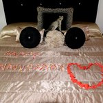 suite bed with anniversary greetings