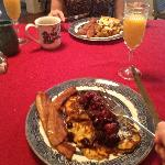 A bad phone photo of our main course for breakfast. I have orange pancakes, my girlfriend had qu