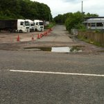 The huge potholed road with a truckers wagon park