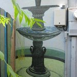 Fountain in semi-private courtyard mural