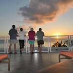 Watching the sunset from our deck at Beachcomber Condos