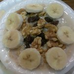 Hot oatmeal with walnuts,banana slices, raisins, butter, brown sugar--yum!