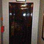 door that leads to hallway of rooms