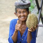 elderly woman posing with fruit