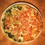 Hawaiian Pizza with half pesto sauce and half marinara
