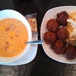 Add a caption bowl of Run Down soup & conch fritters & slaw