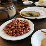 Pin Von lunch - dumplings, peanuts, snail cakes, and pineapple rice