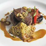 Slow cooked lamb shoulder, green wheat pilaf