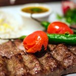 A close up of the Soltani (Filet mignion and Beef Koobideh)