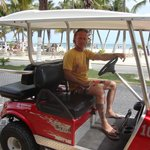 Chris in our golf cart in front of Posada del Mar