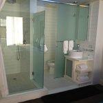 Cool glass enclosed bathroom