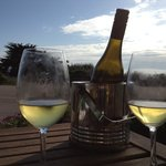 A bottle of wine and a view of the ocean on our patio at Seascape