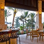 Open air dining areas overlook an infinity pool and views of Sandy Bank Bay.
