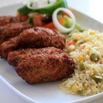 Traditional meatballs with rice and salad