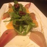 Candy stripes beets with goat cheese, orange segments, candied pecans, and arugula.