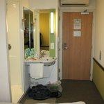 Shower to immediate left, toilet on left, nr door to room