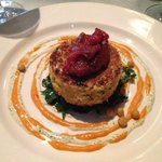 Spiced feta and pistachio couscous cake, sea kale, smoked pepper-almond sauce, orange-mint yoghu