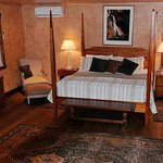 The rustic elegance of our spacious Sinewava Falls King Suite.