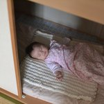 A very comfy baby in the cupboard bed