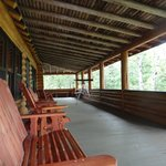 Large porch of main lodge overlooks the lake