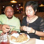 my son Estie and wife Donna enjoying their meal, steak