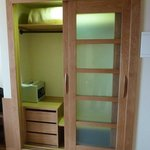 Very spacious lighted closet, with extra blanket and a safe