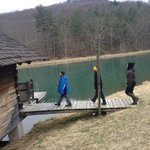 Guests exploring the lake and sauna house