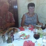 mum and dad in minos enjoying the amazing food