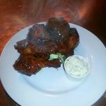 Sticky BBQ Wings with homemade blue cheese dip.