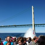 some of the crowd on the boat and the fan tail behind us & the Mackinaw Bridge!