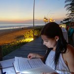 My wife perusing the menu by the beach at The Breeze Samaya