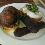 mushrooms, haloumi, spinach and morcilla on harissa olive bread, with poached eggs.
