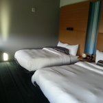 Unconventinal but highly functioanl room. Windows are to the left opposite the beds.