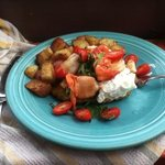 home fries, cherry tomatoes, corned hash, poached eggs and some seafood