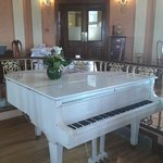 White piano in breakfast room