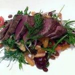 Rare seared kangaroo fillet, poached pear, blue cheese, garlic croutons,