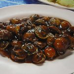Stir-fried sweet and sour spicy cockles