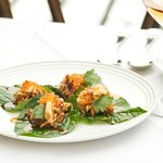 House smoked ocean trout with palm sugar, peanuts and toasted coconut on betel leaves