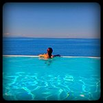watching the beautiful aegean sea view from our private pool.
