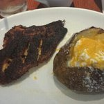 blackened catfish and baked potato. Fish is burnt and I'm glad I like sour cream and cheese beca