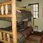 The Trail Lovers room has a queen over queen hand hewn bunk