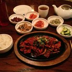 Charim's Jeyuk Bokkeum (spicy grilled pork) with full banchan array.