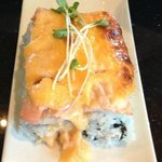 The RIsing Sun Roll (California Roll topped with salmon and dynamite sauce).