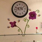 The wall behind the buffet - it's cute! - and the clock.  What time is it?  It's NOW.