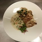 Alaskan Halibut with sauteed wild mushrooms and braised greens over garlic scape risotto