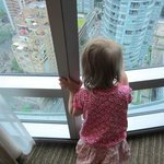 Daughter looking outside from 31 stories up